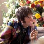 John Lennon sniffs a flower while visiting Maharishi Mahesh Yogi, 1967