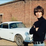 George Harrison next to his Aston Martin at his home in Esher, 1965