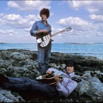 "George Harrison stands and John Lennon lays down during the filming of ""Help!"" in the Bahamas"