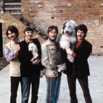 "The Beatles pose in Ringo Starr's backyard, 1967. McCartney holds his sheepdog Martha, who would later be the inspiration for the song ""Martha My Dear"""