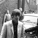 Premier of A Hard Day's Night, crowds gather to catch sight of The Beatles before the Northern premier starts in Liverpool. Ringo Starr pictured here smoking a cigarette after leaving the car. 10th July 1964