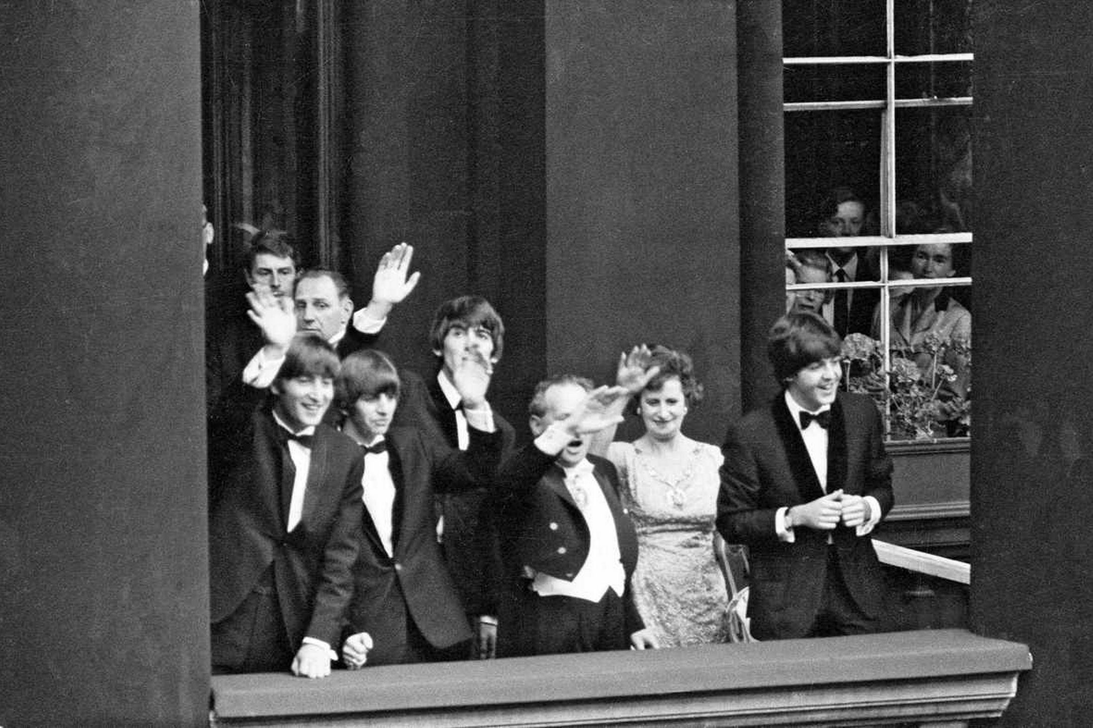 The Beatles in Liverpool for the Premier of a Hard Day's Night. John Lennon, Paul McCartney, Ringo Starr and George Harrison wave from a balcony to crowds of fans in Liverpool. 10th July 1964