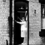 Elsie Starkey, mother of Ringo Starr, July 1964, pictured polishing door knocker at No. 10 Admiral Grove, Liverpool