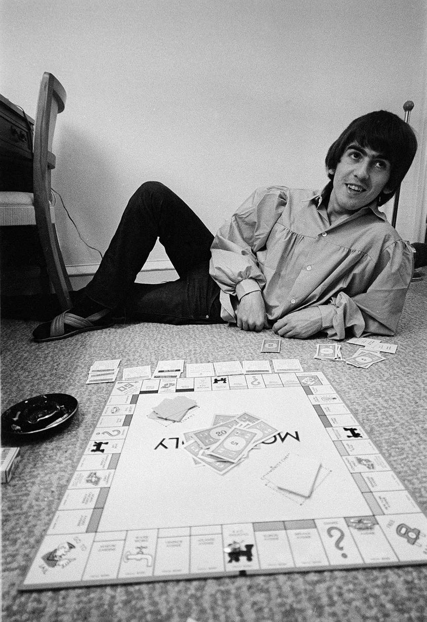 George Harrison Playing Monopoly During The Beatles Tour Of USA At Rented Bel Air