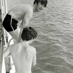 John Lennon and George Harrison of The Beatles go for a swim during their tour of America Circa August 1964