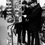 Paul McCartney, George Harrison and John Lennon of the Beatles pop group looking at postcards in Paris. January 1964