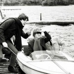 John Lennon and Paul McCartney on a boat at their hideaway in St Fillans Perthshire during their tour of Scotland. October 1964