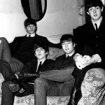 The Beatles sitting on a sofa