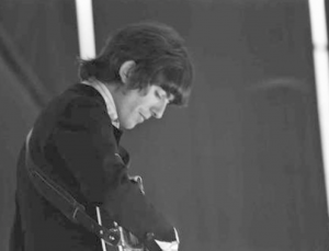 George Harrison onstage during the Bravo Beatles Blitztournee, Grugalle, Essen, Germany, 25 June 1966 Photo © Walter Kohn